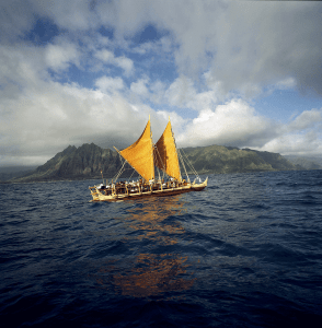 The Hōkūle'a canoe on the water.
