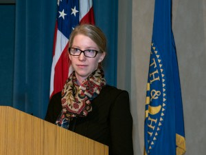 Laura Bothwell stands at a podium.