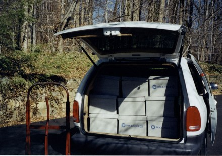 Nirenberg Papers in boxes stacked in the back of a minivan.