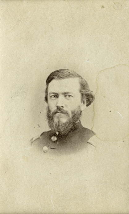 Vignette bust portrait of a young man in a full beard and uniform.