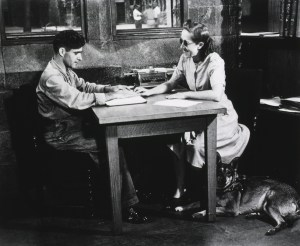 Blind woman teaching a blind man to read Braille
