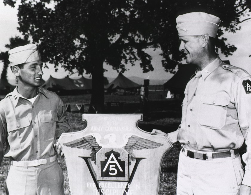 Army plaque being awarded