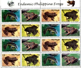 16 stamps, each featring a color photograph of a frog.