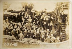 Crewmen in uniform assembled on the ship's deck