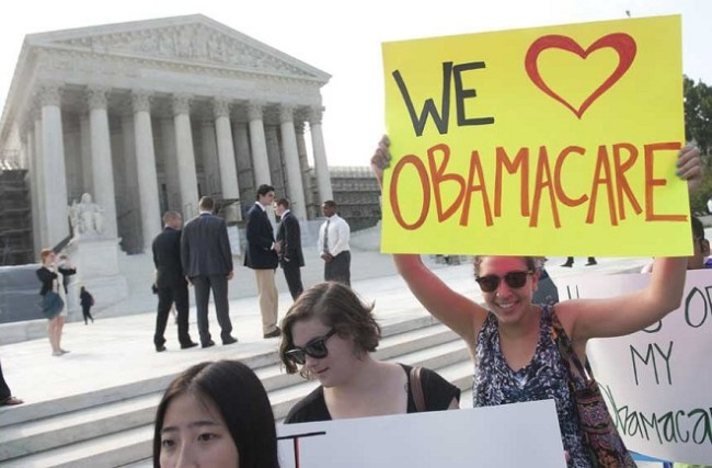 In front of the Supreme Court, demonstrators await a decision on the Affordable Care Act, June 28, 2012 Courtesy Saul Loeb/AFP/Getty Images