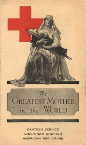A poster of a nurse in a Pieta pose holding a soldier on a streatcher with the Red Cross symbol in the background.