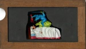 Wooden framed glass slide with color image.