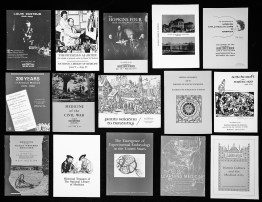 A photograph of a group of catalogs for exhibitions produced by the Library.