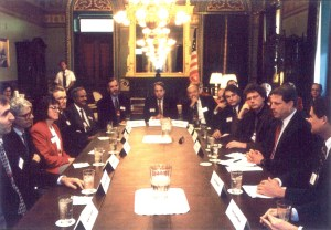 Al Gore, and PITAC members around a table.