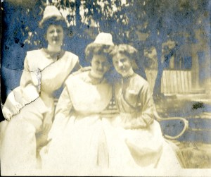 Cornelia Mercer with two fellow nurses, all posing for the camera in white uniforms