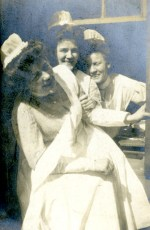 Cornelia Mercer and two other nurses smile and laugh as they pose for the camera