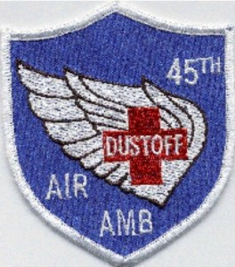 A uniform patch, a blue shield with white wings and a red cross reading 45th DUSTOFF AIR AMB