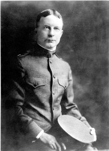 Black and white photographic portrait of Fielding H. Garrison; half-length, seated, right pose, full face, wearing uniform.