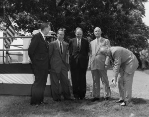 Black and white photograph of five men in suits.