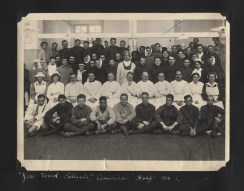 A photograph of patients, doctors, and nurses gathered for a portrait.