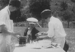 A boy recieves a vaccination from a nurse outdoors.