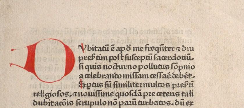 Detail from a printed page in Latin in one column with handwritten initial letters in red.