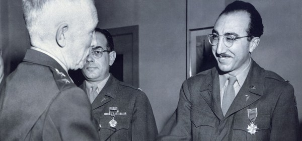 DeBakey, in uniform, shaking hands with an older man.