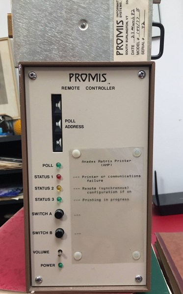 An electronics box resembling a desktop computer with switches and indicator lights.