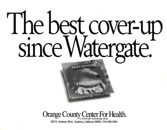 Advertisement featuring a black and white photo reproduction of an unopened Trojan condom
