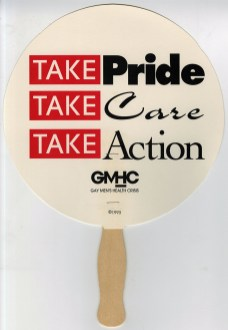White, round paper fan with wooden handle handed out to the public by members of the Gay Men's Health Crisis