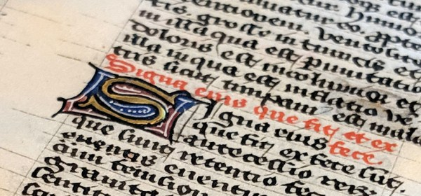 A small illuminated and gilded initial.
