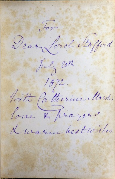 Handwritten cursive inscription in blue ink.