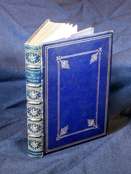 Blue leather bound book with gold details.