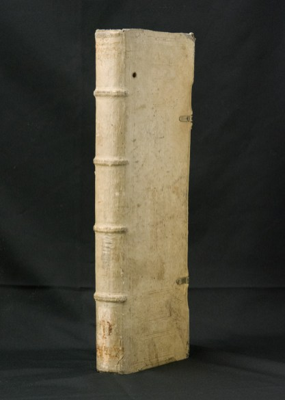 A tall leather bound book with embossing and metal clasps.
