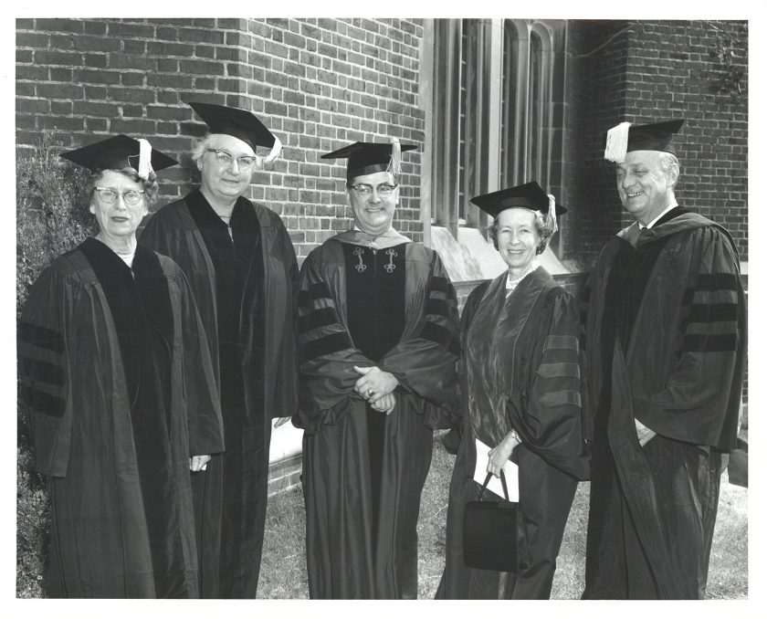 Two men and three women pose in academic regalia.