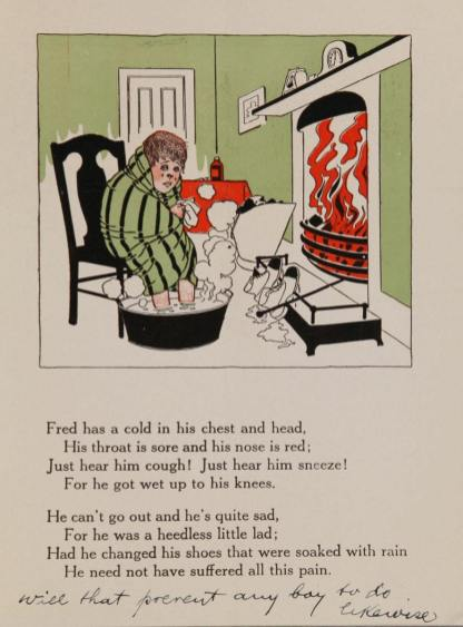 A boy huddled in a blanket with his feet in hot water sites close to a roaring fire.