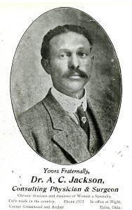 A newspaper photograph of a black man in a suit and tie.