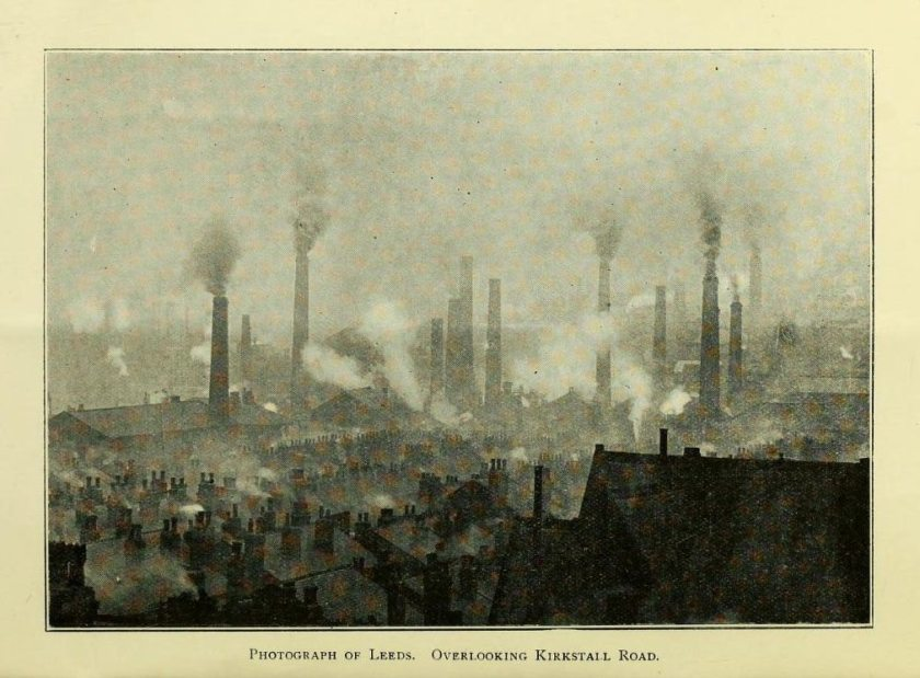 Halftone photograph from a book showing an industrial area with many smokestacks polluting the air.