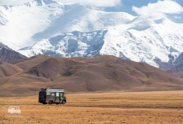 Vast fields dotted by yurts and their cattle are surrounded by impressive mountains reaching 7000 meter.