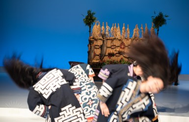The black hair dance. The female dancers clad in traditional costumes embroidered with patterns said to ward off evil. Shaking their head up and down, and swinging their hair wildly to portray a pine tree swayed by winds.