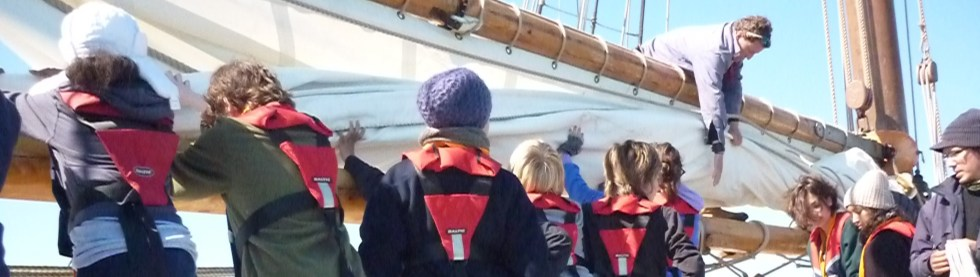 Teamwork on Queen Galadriel to stow the sails