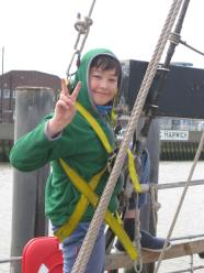 boy climbing rigging smiley