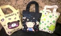 Tas Kantong ukuran medium bermotif hewan dan tumbuhan..