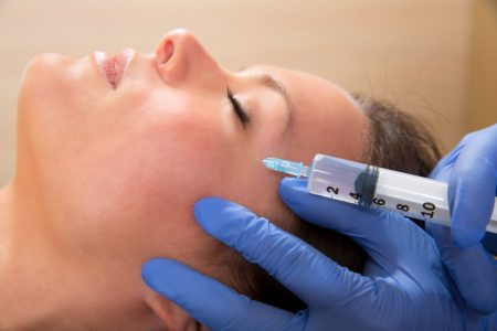 Mesoterapia - Anti aging facial mesotherapy syringe on woman face