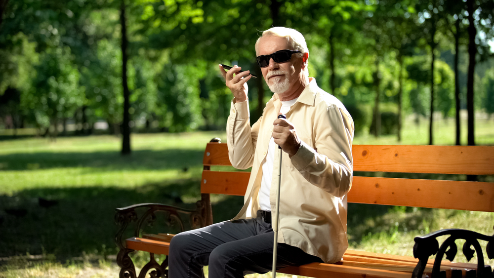 Visually Impaired Man using a device