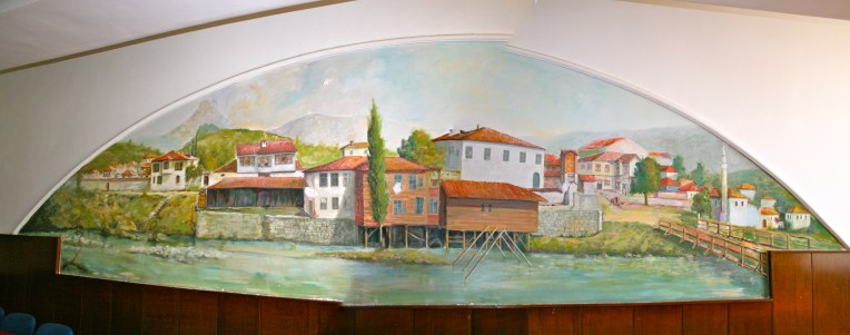 Mural painting of famous Ibar River/Mitovica scene, on wall of room inside Cultural Centre, Mitrovica, Kosovo.