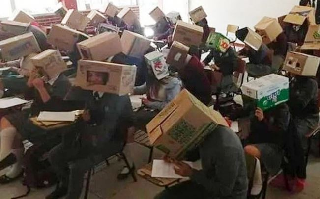 Teacher forced Students to wear Cardboard boxes to curb Examination Malpractices 1