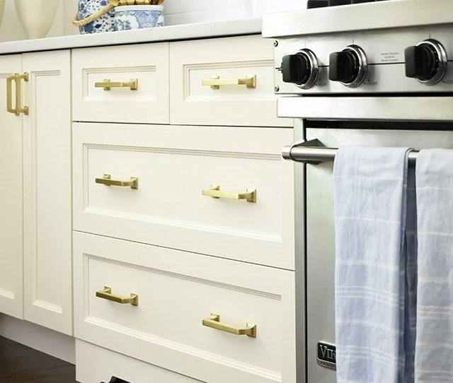 Ivory Kitchen With Brass Hardware Drawer Pulls