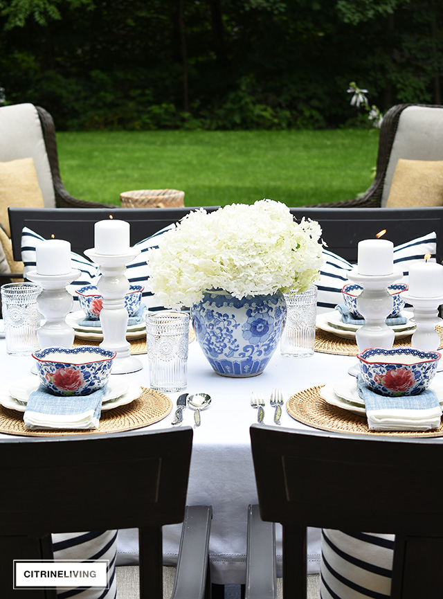 Ginger jar with fresh hydrangeas and vintage-inspired dishes