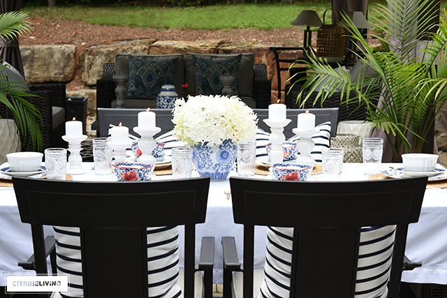 Outdoor late summer tablescape with vintage inspired dishes and blue and white.