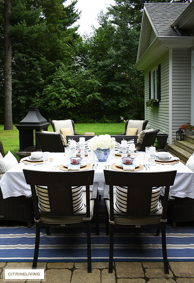 Late summer tablescape with vintage inspired dishware and blue and white details.