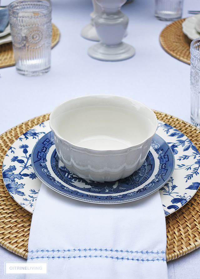 Vintage inspired outdoor late summer tablescape with blue and white dishes.