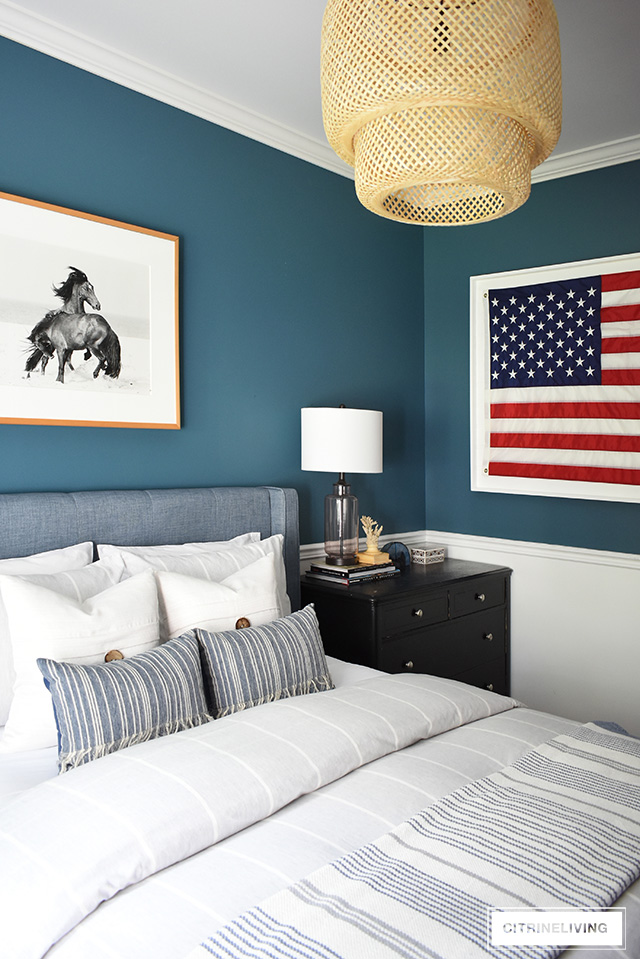 Modern coastal teen bedroom for boys - American flag, striped bedding, blue walls and woven elements are clean and timeless with a modern edge.