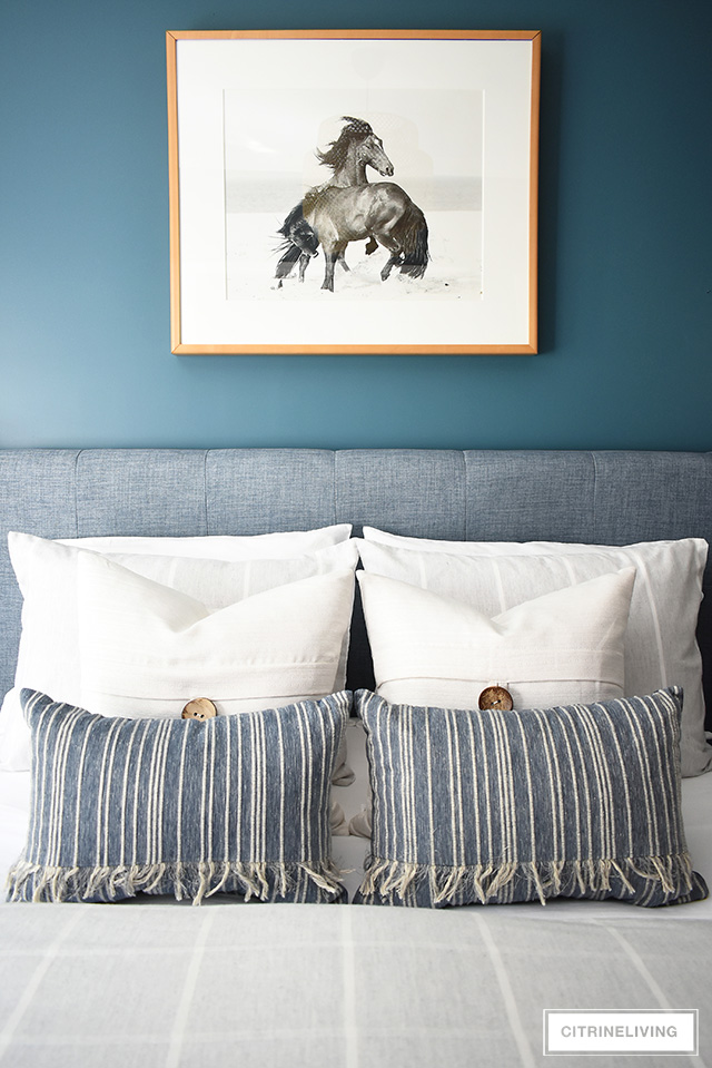 Modern coastal teen bedroom - striped and textured throw pillows paired with beach-themed horse photographer.