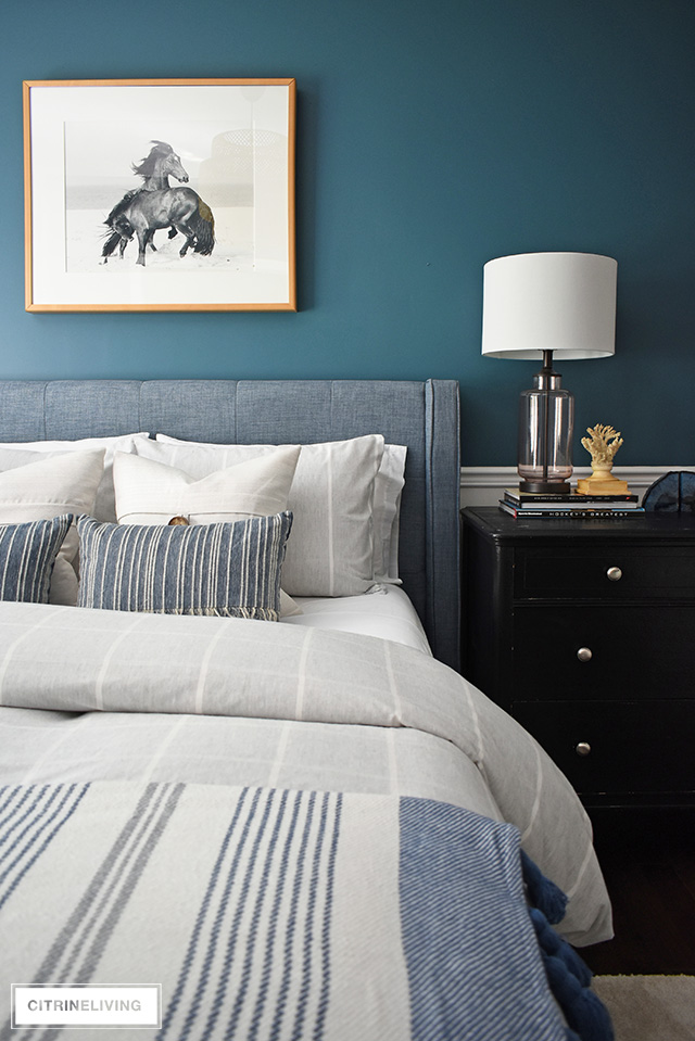 Modern coastal teen bedroom - striped bedding, glass lamp, coral and agate accessories. Black and white beach-inspired horse photographer.